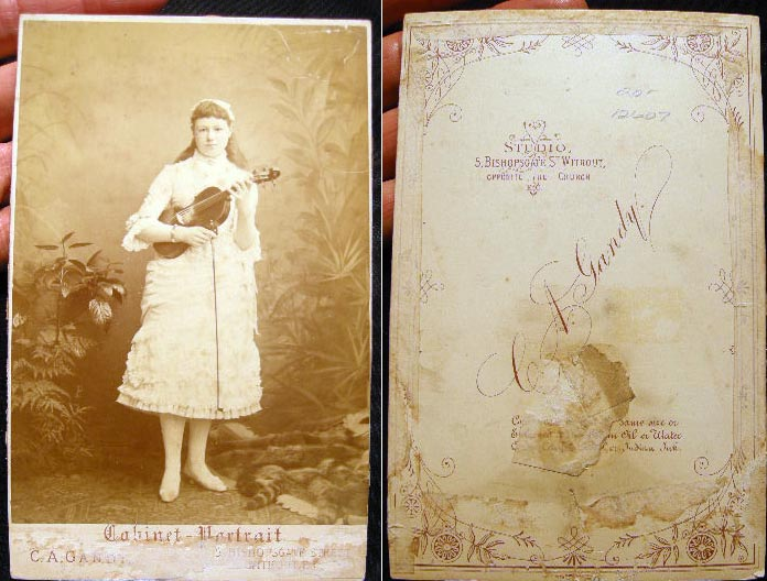 Cabinet Card By C.A. Gandy Bishopsgate of an Unidentified Female Violin Player, Holding Instrument with Fingers on Neck-Strings and Bow in Hand. Violin.