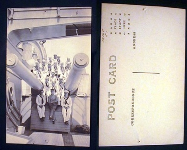 Real Photo Postcard of US Navy Personnel Sitting on Gun Carriage of Ship. World War II.
