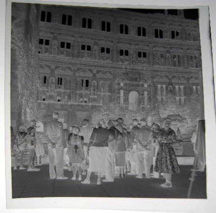 Photographic Negative of a Decorated municipal Building with Crowd of Visitors in Foreground, with Professional Camera Stand Tripod & Cloth Just Visible on Right of Image; Possibly Germany Circa 1949. Photography.