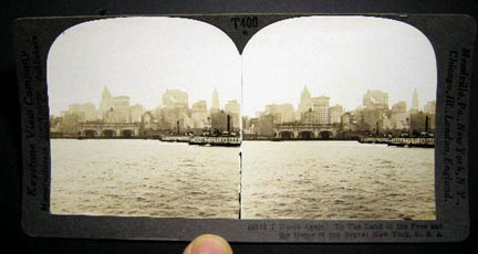Stereoview Photograph Of Home Again! To the Land of the Free and Home of the Brave! New York, U.S.A. By Keystone View of New York City Skyline from the Water, Two City of New York Plant and Structures Boats in the View. New York City.