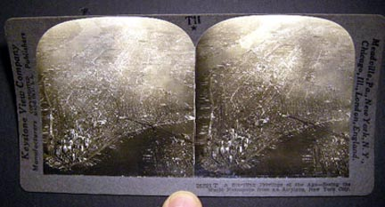 Stereoview Photograph Of A Startling Privilege of the Age - Seeing the World Metropolis From an Airplane, New York City By Keystone View Company. New York City.