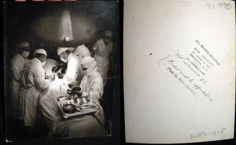C. 1940 Press Photograph of an Operating Room with Surgery Underway By Bob Leavitt Brooklyn New York and Initialed by Him. Photography - Medicine.
