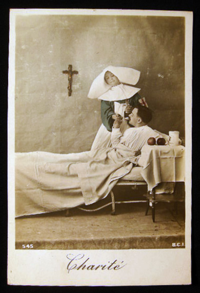 """Circa 1916 """"Charite"""" Real Photo Postcard with Hand Coloring & Gold Highlights of a French Nursing Sister Giving a Patient Medicine. France - Photography - Nursing - Real Photo Postcard."""