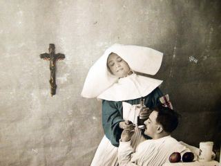 """Circa 1916 """"Charite"""" Real Photo Postcard with Hand Coloring & Gold Highlights of a French Nursing Sister Giving a Patient Medicine"""