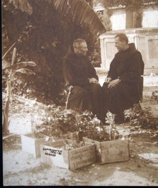 1908 Photograph of Two Franciscan Monks Seated in a Tropical Memorial Garden Signed N. Maceo